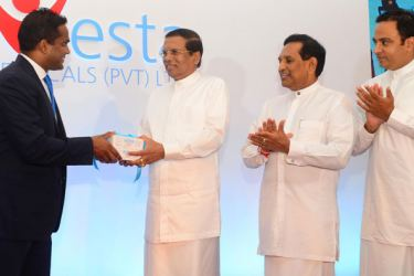 The  management of  Navesta Pharmaceuticals hands over a sample of drugs  to President Maithripala Sirisena while the Health  Minister and others look  on.