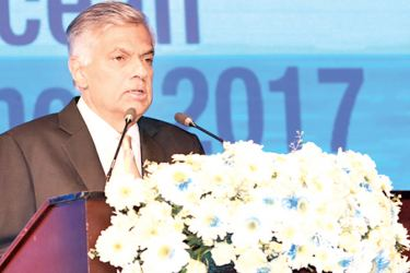 Prime Minister Ranil Wickremesinghe addressing the conference