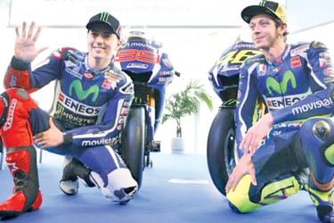 Yamaha's MotoGP riders Jorge Lorenzo (L) and Valentino Rossi pose with the new Yamaha YZR-M1 for the 2016 season in Barcelona, Spain.