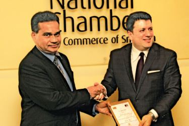G. Deepal Nelson, Secretary of The National Chamber of Commerce of Sri Lanka, handing over a token of appreciation to Afghanistan Charge d'Affaires to Sri Lanka, Munir Ghiasy. Picture by Shan Rambukwella
