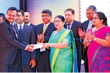 Chairperson Insurance Board of Sri Lanka Indrani Sugathadasa accepting the first day cover. Pictures by Chinthaka Kumarasinghe