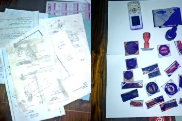 The seized forged  documents and franks.