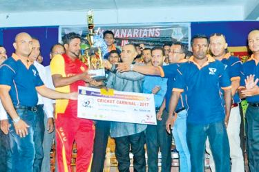 The skipper of O/L Batch -2007team of Maruthamunai Al-Manar Central College receiving the champion trophy from Former Local Government and Provincial Councils Minister and National Congress Leader A.L.M.Athaullah. Picture by: I.L.M.Rizan