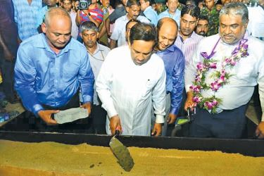 Health Minister Rajitha Senaratne laying the foundation stone for the Base Hospital and Ayurvedic Research Centre.