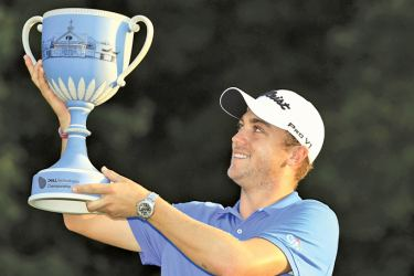 Justin Thomas of the United States poses with the trophy after winning the Dell Technologies Championship at TPC Boston on September 4. AFP