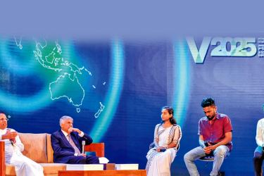 President Maithripala Sirisena and Prime Minister Ranil Wickremesinghe participating in a Question and Answer session with five youth at the ceremony to launch the eight year economic plan Vision 2025 of the Unity Government, at  the BMICH yesterday.