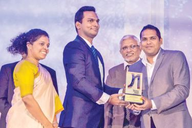 Nilmini Ferdinando, Marketing Communications Manager and Sanjeewa Warusawitharana, Manager - Digital Media and Business Development at Litro Gas Lanka Limited receiving the award for the Overall Winner for the Best Digital Integrated Campaign