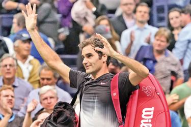 Roger Federer of Switzerland waves to the crowd after losing to Juan Martin del Potro of Argentina in the US Open men's singles quarter-finals. – AFP
