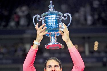 Rafael Nadal of Spain poses with the championship trophy during the trophy ceremony after defeating Kevin Anderson of South Africa during their Men's Singles finals match on Day Fourteen during the 2017 US Open on September 10. AFP