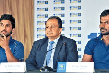Sri Lanka Cricket CEO Ashley de Silva is flanked by Test captain Dinesh Chandimal and ODI and T20I captain Upul Tharanga at the media conference held at the SLC headquarters yesterday. Pic by Rukmal Gamage