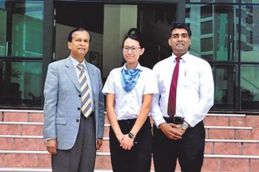 SAARC student Deki Wangmo from Bhutan flanked by Chairman, SLITHM, Sunil Dissanayake and Director General, SLITHM,  Buddika Hewawasam