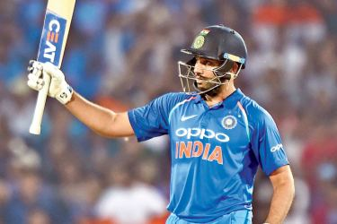 Indian cricketer Rohit Sharma celebrates after scoring a century (100 runs) during the fifth one-day international cricket match against India at the Vidarbha Cricket Association Stadium in Nagpur on October 1.  - AFP