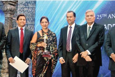 Ceylon Biscuits once again emerged as the most outstanding exporter of the year at the NCE export awards. Here Sharmalee Wickramasinghe, Managing Director, Ceylon Biscuits Limited is seen after receiving the award with Prime Minister Ranil Wickremesinghe and other officials. Picture by Sulochana Gamage