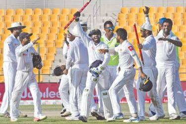 Sri Lankan cricketers celebrate after victory on the fifth day of the first Test cricket match between Sri Lanka and Pakistan at Sheikh Zayed Stadium in Abu Dhabi on October 2. AFP