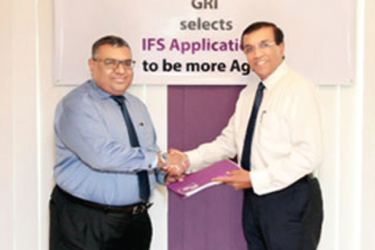 Jayantha De Silva, President and CEO for IFS Sri Lanka handing over the agreement to Prabhash Subasinghe, Managing Director Global Rubber Industries (Pvt) Limited (GRI)