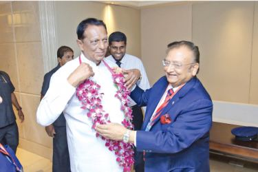Minister of Tourism Development and Christian Religious Affairs, John Amaratunga is welcomed by President, IATO Pranab Sarkar