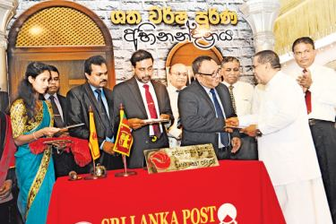 Transport and Civil Aviation Minister Nimal Siripala De Silva at the issue of a Stamp and First Day Cover to commemorate the 100th anniversary of the Colombo Fort Railway Station yesterday. Picture by Wimal Karunathileke