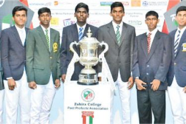 The captains of the teams with Zahira Super 16 Soccer champion trophy. Picture by Ruzaik Farook