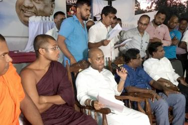 Agriculture minister Duminda Dissanayake listening to the grievances of the unemployed graduates.
