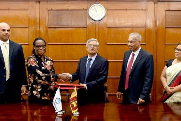 Finance and Mass Media Ministry Secretary Dr. R.H.S. Samarathunga and World Bank Country Director for Sri Lanka and Maldives Idah Z. Pswarayi-Riddihough exchanging the Agreement.