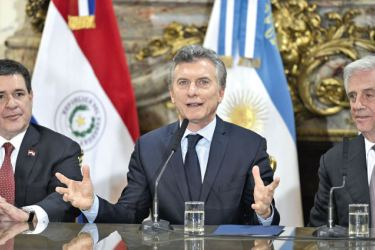 Argentine President Mauricio Macri (C) speaks to the press next to his counterparts Horacio Cartes (L) of Paraguay and Tabare Vazquez of Uruguay after holding a meeting at the Casa Rosada presidential palace in Buenos Aires on October 4. AFP