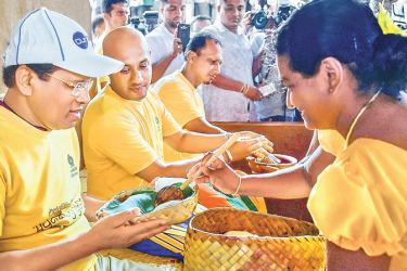 President  Maithripala Sirisena  participating in the National Vap Magul  Ceremony for 2017/ 18 Maha Season at  Thibbotuwawa Paddy field in Kekirawa   yesterday.  Ministers Duminda  Dissanayake and  P Harrison were   present . Pictures by Sudath Silva