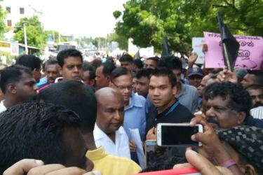 Parliamentarians Namal Rajapaksa and Prof. G.L.Peiris among the participants in the protest.