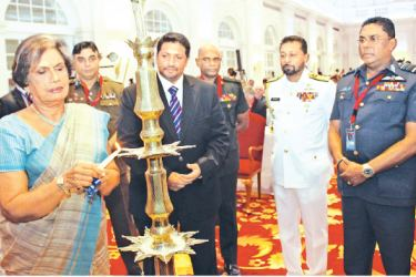 Former President Chandrika Bandaranaike Kumaratunga graced the opening of the 2017 Galle Dialogue at Galle Face Hotel yesterday and was invited to light the traditional oil lamp along with Chief of Defence Staff Admiral Ravindra Wijegunaratne, Navy Commander Vice Admiral Travis Sinniah, Army Commander Lt.Gen.  Mahesh Senanayake and Inspector General of Police Pujith Jayasundera. Picture by Roshan Pitipana