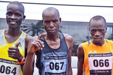 Men's full marathon winners: From left - Amos Myindi (third), Peter Ketter (second) and James Talam (first) - all from Kenya