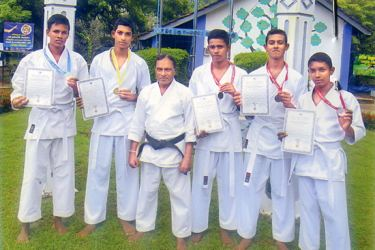 Karate Medalists of Wadduwa Central College (from left) K.G.M. Sachintha Kularathna (Under 21) (Kata event 2nd place – Silver medalist) T. Santhush Chethika (under 16) (1st place – Gold Medallist – Kata event) Shihan L.P. Edirisinghe (Chief instructor Black Belt and Kalutara District Chairman of Karate Do Association). G.P.R. Roshitha Perera (under 21) Kata event Third place Bronz Medallist B. Thilina Dilshan (Under 21) Kata event Third Place Bronze medlaist Chinthaka Lahiru (Under 16) Kata event third plac