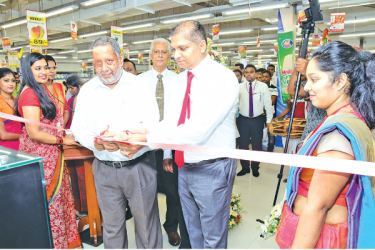 Cargills Bank Ratnapura being opened by Chief Guest, Rajendra Theagarajah – Joint Deputy Chairman, Cargills Bank Limited in the presence of Guest of Honor  Sahan Ganegama - Deputy General Manager-Retail, Cargills Foods Company and. Sarath Dissanayake, Company Secretary- Cargills (Ceylon) .