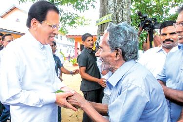 President Maithripala Sirisena speaking to a villager. Picture by President's Media