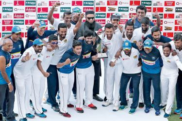 Sri Lanka cricketers savour their series win over Pakistan with the series trophy. AFP