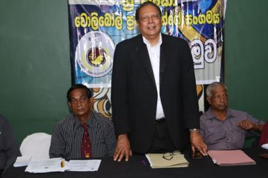 The President of Sri Lanka Veterans' Volleyball Association Mervyn Fernandopulle speaking at the media briefing. (from left) SLVVA Vice President N.D. Gunasena, Secretary Ranjith Premarathne, Treasurer Frank Fernando and former Secretary K.S. Peiris are also in the picture.