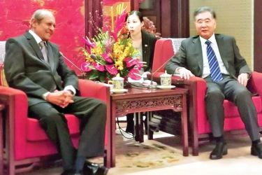 Chinese Vice Premier Wang Yan and Foreign Affairs Minister Tilak Marapana are in discussion during the latter's official  visit to China.
