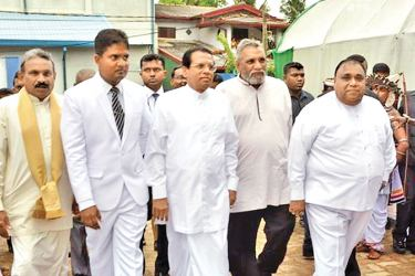 President Maithripala Sirisena being escorted to the venue by Southern Province Governor Dr. Hema Kumara Nanayakkara, Provincial Education Minister Chandima Rasaputra, Elections commissioner Mahinda deshapriya and Chief Minister Shan Wijayalal De Silva.  Galle Central Special Corr.
