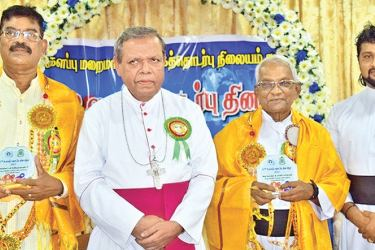 Batticaloa Bishop Rt. Rev. Dr. Joseph Ponnaiah with the award winners.  Picture by Sivam Packiyanathan.