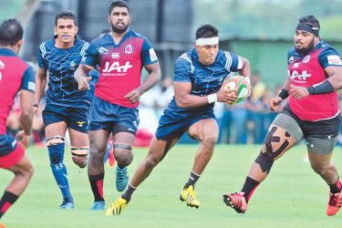 Air Force attacker trying to escape from CR defenders, Udara Gayan (extreme right), kavindu De Costha (No.9) and Joel Perera (extreme left). Picture by Wasitha Patabendige