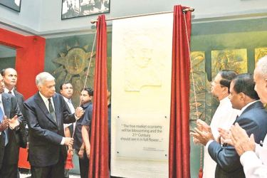 President Maithripala Sirisena and Prime Minister Ranil Wickremesinghe unveil a plaque in honour of former President J.R. Jayewardene, at the 40th anniversary celebrations of the BOI, at the Katunayake Export Processing Zone, last September. Minister of Development Strategies and International Trade Malik Samarawickrama and BOI officials are present.