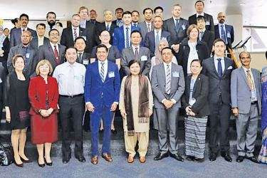 State Minister Sujeewa Senasinghe with officals at the UNESCAP committee