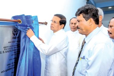 President Maithripala Sirisena unveiling the plaque. Picture by Sudath Silva