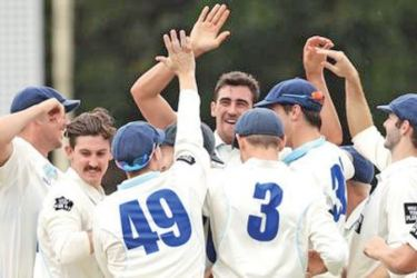 Mitchell Starc is congratulated by team mates after performing his second hat-trick.