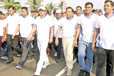 President Maithripala Sirisena participating in the National Diabetes Day Walk at Galle Face Green yesterday. Minister Dr. Rajitha Senaratne, IGP Pujith Jayasundara, Diabetes Congress President Dr. Prasad Katulanda and Dr. Manilka Sumantilleke also participated. Picture by Chandana Perera, President's Media Unit