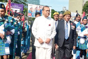 Chief Guest, Speaker Karu Jayasuriya being escorted to the Poppy ceremony held at the Viharamaha Devi Park in Colombo on Saturday.