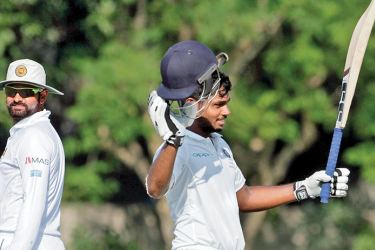 Sandu Samson captain of the Indian Board President's XI team celebrates his century against the touring Sri Lankans on the second day of the two-day warm-up match that ended in a draw at University grounds Kolkata on Sunday.
