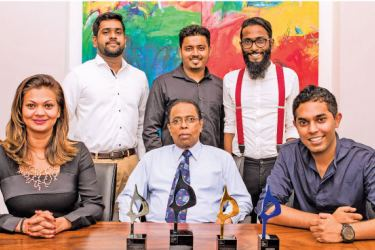 Irvin Weerackody, Chairman of Ogilvy Group Sri Lanka (centre) with Ogilvy Public Relations' CEO Manilka Philips (left), Assistant General Manager Althaf Jalaldeen, (right) and Lasantha David, Janaka Dilan and Gayan Satharasinghe