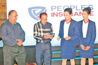 Jehan P. Amaratunga - Chairman relaunching the brand's new logo along with Deepal Abeysekera - CEO of Peoples Insurance