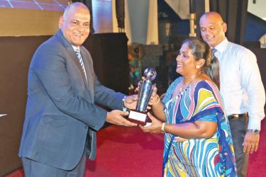 Mother of Jehan Daniel receiving the most outstanding Josephian sportsman for the year 2016 award on behalf of her son from chief guest Dushan Soza.