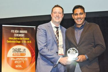 SriLankan Airlines Country Manager Singapore Mohan Meegolle (right) receiving the award at the Future Travel Experience Asia Awards 2017 last week