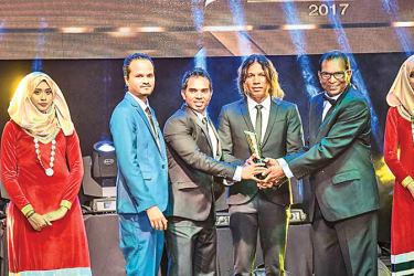 Cinnamon Dhonveli Maldives, General Manager, Nalinda Liyanage along with Assistant Manager- Operations, Hassan Shihab and Atoll Travel Surf, Operations Manager, Dara Ahamed accepts the Gold award for 'Leading Surf Resort'